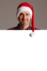Man in Santa hat with banner