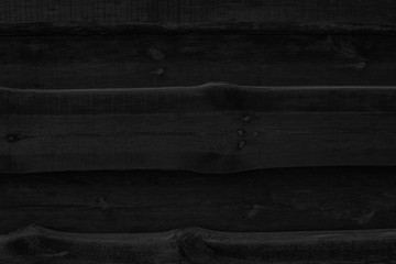 Black charcoal board, background of burnt wood texture.