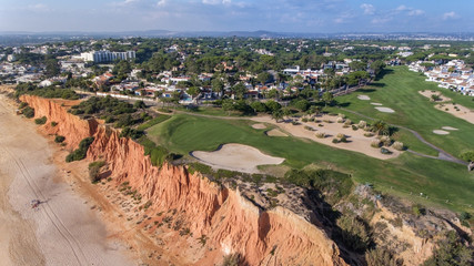 Aerial. View from the sky at the golf courses in the tourist town Vale de Lobo. Vilamoura.