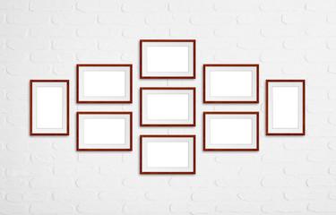 Photo frames collage, nine brown wooden frameworks mock up on white bricks wall