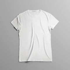 Studio template of clothes with  blank t-shirt lies on the on gray background.
