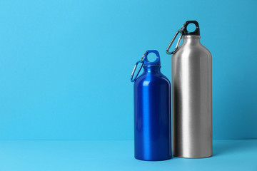 Sport bottles with space for text on color background