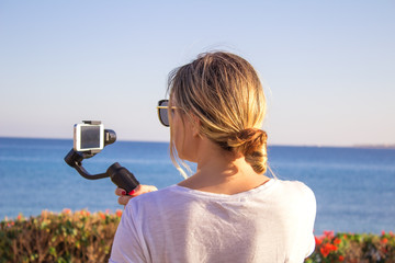 Selfie portrait travel woman recording video vlog on mobile phone