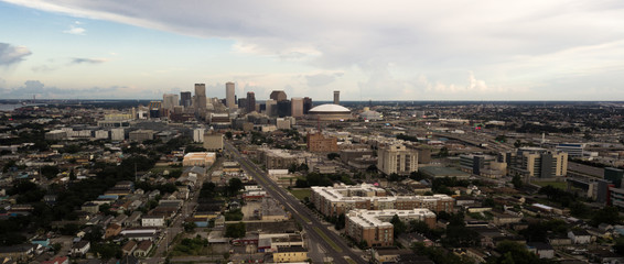 The Sun Peaks out through storm clouds lighting downtown New Orleans