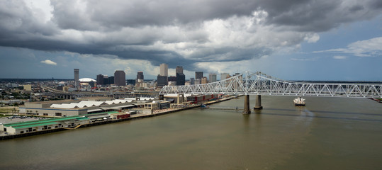 Afternoon Storm Clouds Pass Over Highway Bridges Barges Moving Waterfron New Orleans