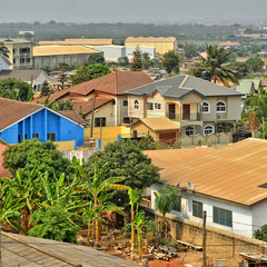 Residential area in Africa. Top view on houses surrounded by fences and gardens. Modern lifestyle in developing countries. Beautiful urban landscape