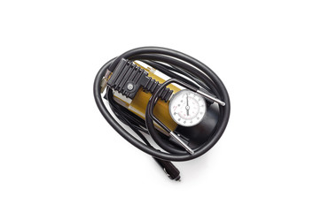 Car pump auto air compressor isolated on the white background.