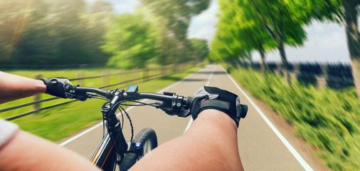Man riding on bicycle, fast speed, aging effect