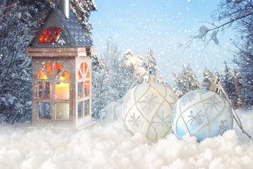 Image of christmas festive tree white ball decoration in front of magical winter landscape background.