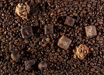 Chocolate pieces and coffee beans close up