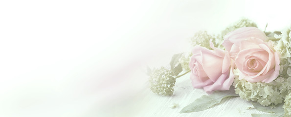 Beautiful rose flowers on wooden background