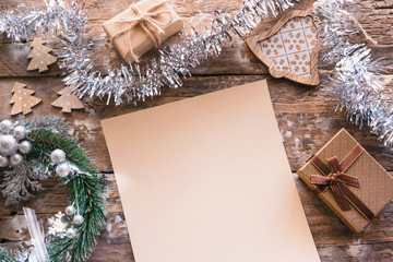 wish list christmas letter on wooden background with decorations mockup