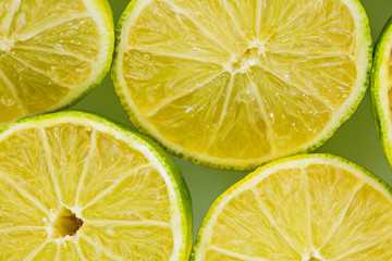 Lemon slices on green background.
