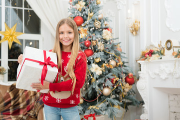 The morning before Xmas. Little girl. Happy new year. Winter. xmas online shopping. Family holiday. Christmas tree and presents. Child enjoy the holiday. Best wishes