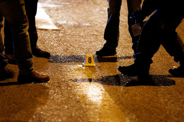 A marking is seen on the road at the scene of what an initial report from the Israeli army said was a shooting attack, near the Israeli settlement of Ofra, in the occupied West Bank