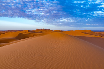 Beautiful colorful sunset in Erg Chebbi Dunes, Sahara Desert, Merzouga, Morocco, Africa