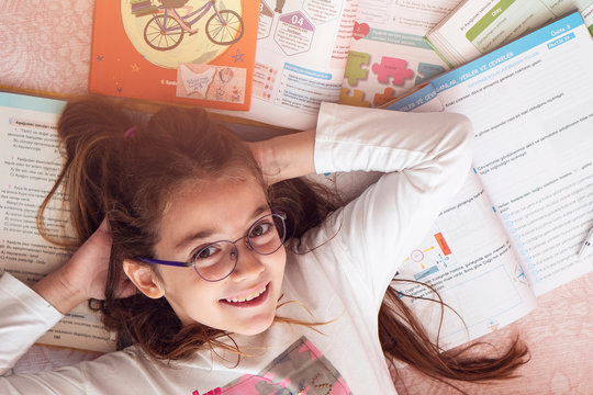 Cute girl storybook on the floor
