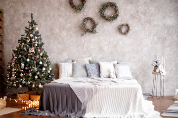 Christmas decorated bedroom interior. Cozy home moment. Concept Happy New Year