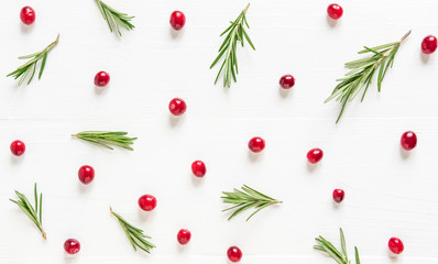 Cranberry pattern on white wooden background. Background with cranberries. Useful berries. Flat lay, top view.