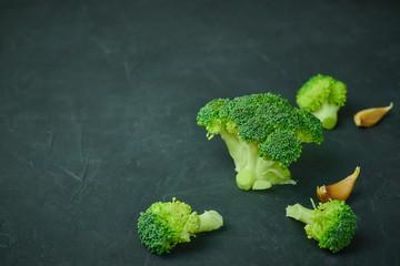 Green broccoli segments healthy food pattern on dark background. Copy space. vertical view. Vegetarian food. macro photo of vegetables.