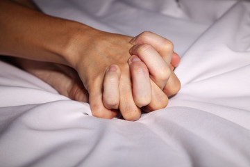Couple holding hands passionately