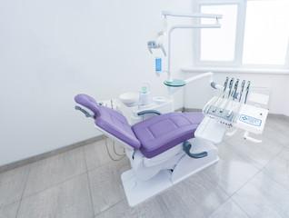 dental ordination cabinet purple chair modern clinic wide angle