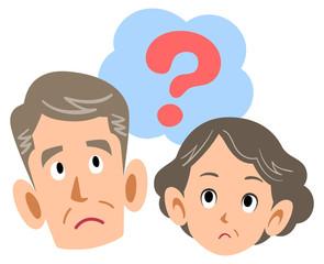 疑問を持つシニアの夫婦 中高年 老人