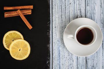 hot coffe, cinnamon sticks and lemon slices