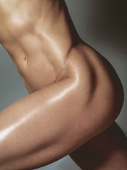 Nude athletic woman body. Artistic photo.