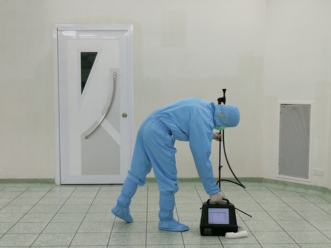 Inspector are testing dust inside the operating room with Particle Counter.