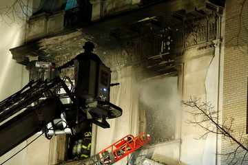 Fire crew work at the site of a fire at the Serbian Mission on the Upper East Side of Manhattan in New York City