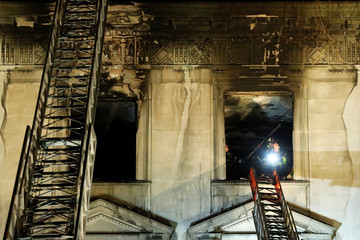 Fire crew work at the site of a fire at the Serbian Mission in New York City
