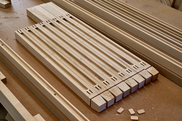Wooden elements of a children's bed. Furniture manufacture. Close-up