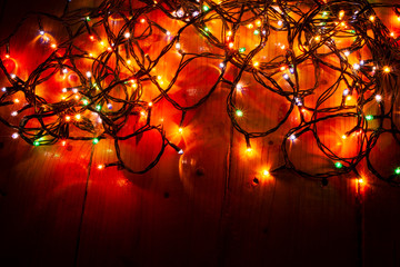 colorful red holiday lights on the floor Christmas background