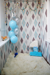 Place for a photo shoot with balloons and a number one. Celebrating a child's birthday for one year