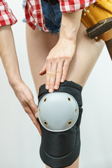 Person trying on knee pads