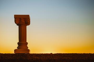 Greek column against evening sky