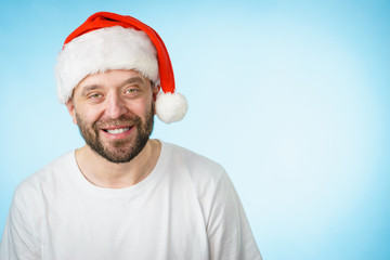 Smiling man in santa claus hat portrait