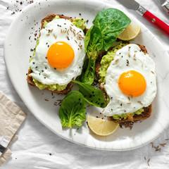 Deurstickers Gebakken Eieren Top view healthy avocado toasts breakfast lunch avocado toast fried eggs white background