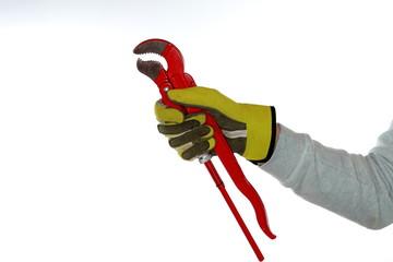Arbeiter mit Handschuh hält Zange