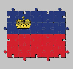 Jigsaw puzzle of Liechtenstein flag in blue and red, charged with a gold crown. Concept of Fulfillment or perfection.