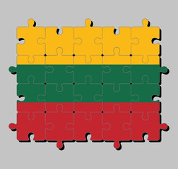 Jigsaw puzzle of Lithuania flag in horizontal yellow green and red. Concept of Fulfillment or perfection.