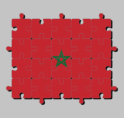 Jigsaw puzzle of Morocco flag in red field with a black-bordered green pentagram. Concept of Fulfillment or perfection.