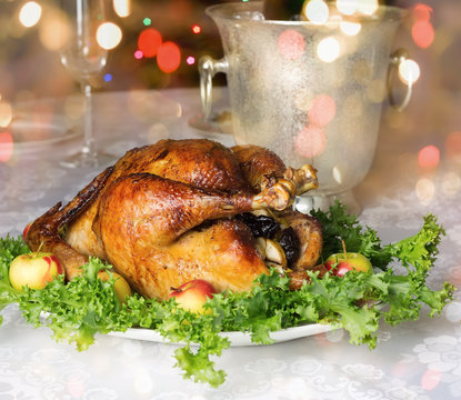 Christmas table with roast capon.