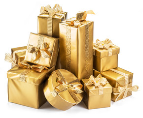 Golden gift boxes as a symbol of wishes and celebration on white background.