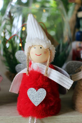 Cute Christmas angel doll with heart on her red dress