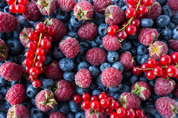 Ripe blueberries, raspberries and red currants. Mix berries and fruits. Top view. Background berries. Various fresh summer fruits. Red and blue food. Fresh berries closeup.