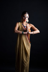 Caucasian brunette woman in brown indian national dress sari