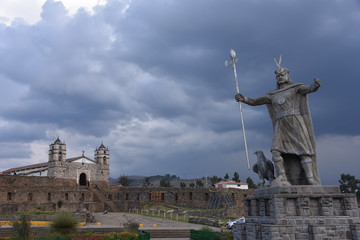 A statue of Inca Pachacutec and Catholic church in the plaza of Vilcashuaman. Ayacucho, Peru