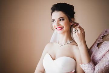 Beautiful fashion bride in wedding dress posing